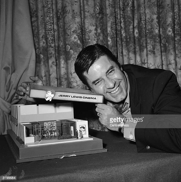 American actor screenwriter film director and producer Jerry Lewis shows off his plan to open a network of cinemas across Europe while at a press...