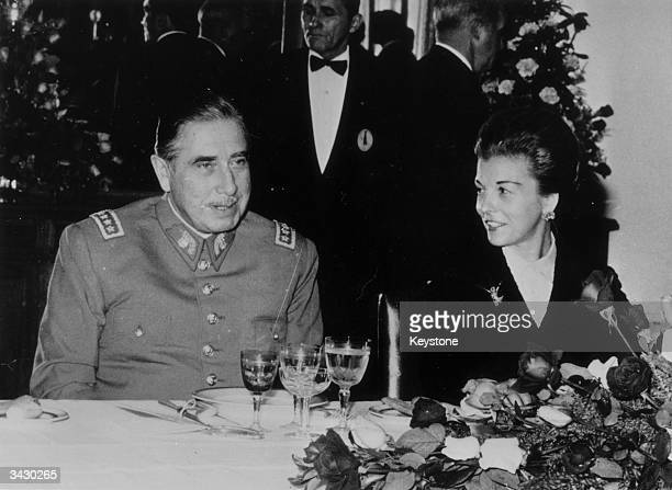 General Augusto Pinochet the President of Chile with the Argentinian President Maria Estela Martinez De Peron at a dinner given in his honour in...