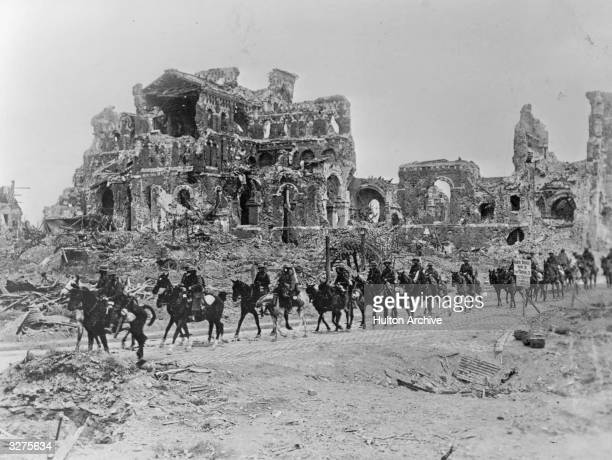 The British Cavalry passing the remains of Albert Cathedral after the 2nd Battle of the Somme
