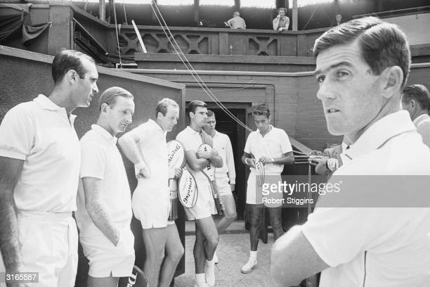 Professional tennis stars line up for a practice session at Wimbledon south London The two furthest left are Andres Gimeno and Rod Laver and Ken...