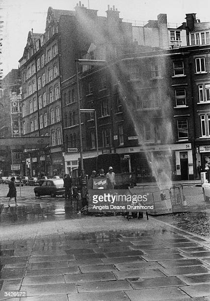 A water spout in central London caused by London Electricity Board workmen drilling into a water main by mistake