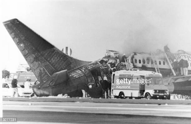 Emergency services at work on the Boeing 737 which burst into flames during takeoff at Manchester Airport Fiftyfour people lost their lives on the...