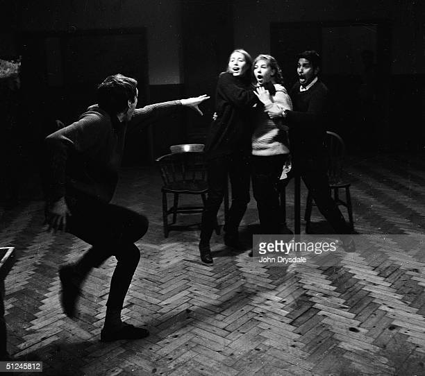 22nd December 1962 Drama students Allyn Morris Elizabeth Roland Lynette Reade and Kenneth Rohee improvise a scene at the East Fifteen acting school...