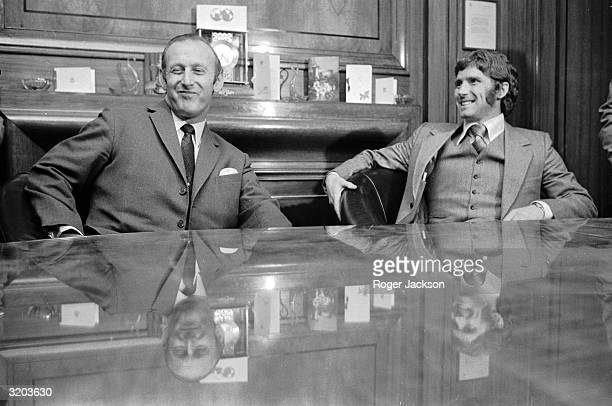 Everton striker and star of England's winning 1966 world cup team Alan Ball sits with Arsenal manager Bertie Mee after signing to the North London...