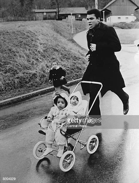 Muhammad Ali trains in Zurich for his fight against the West German Jurgen Blin with his twin daughters Jamillah and Rasheda