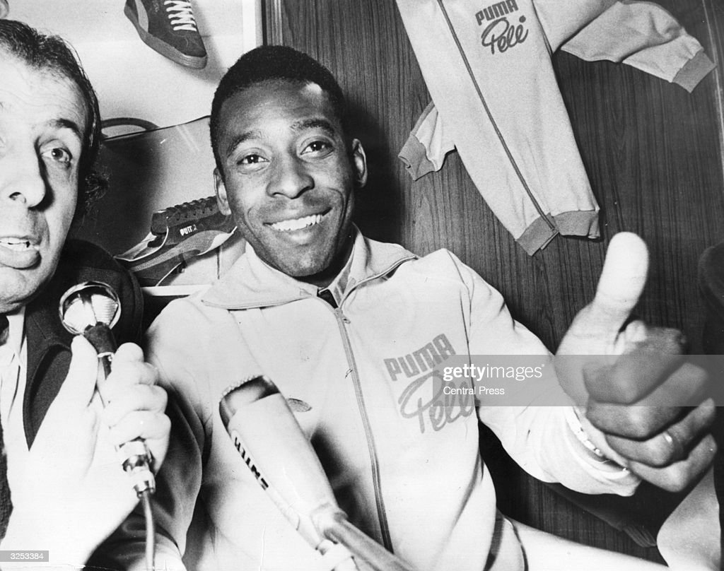 Pele the famous Brazilian footballer gives the thumbs-up sign during a press conference in Paris, where he is taking part in a match at the Exhibition Park.