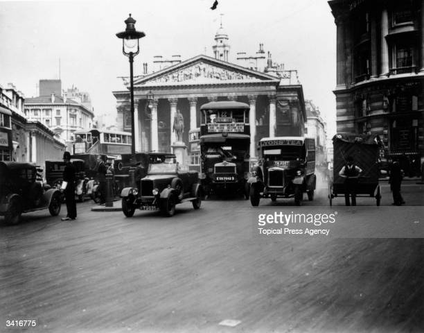 The busy traffic outside the Royal Exchange in London