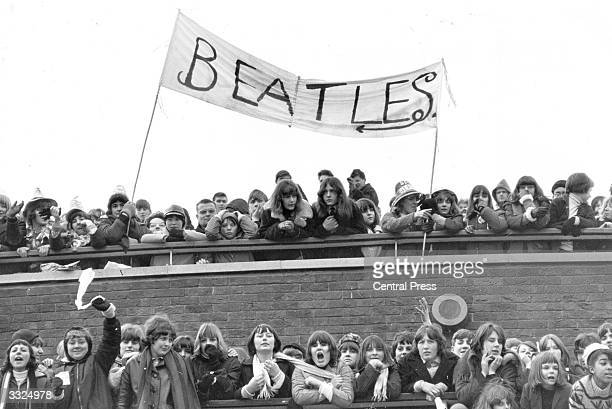 A crowd of fans of British pop group The Beatles at London Airport where the group is due to take a flight to the Bahamas to film 'Help'