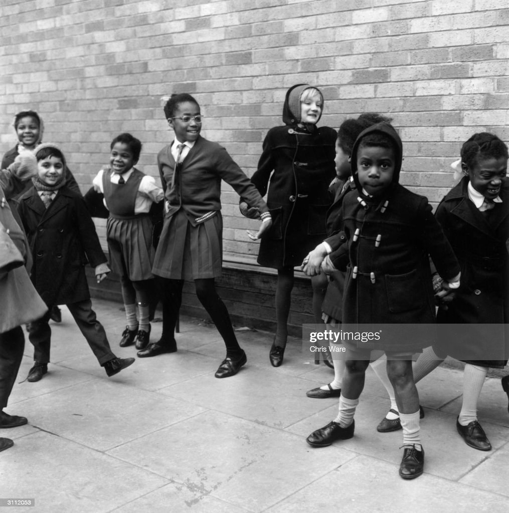 Black and white children playing happily together at West Park School Wolverhampton