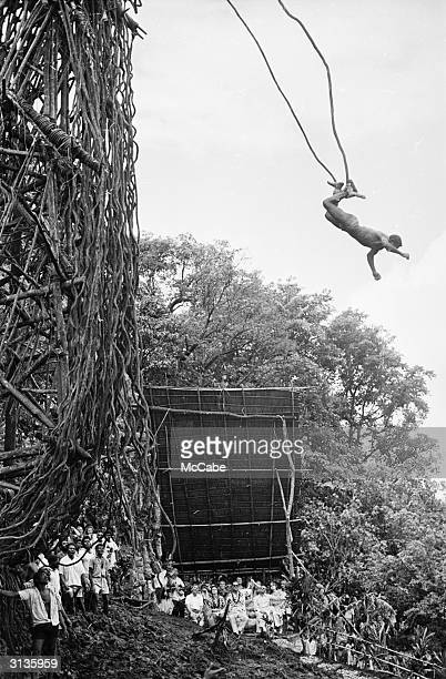People watching John Tabi perform a land dive from a bamboo platform during a visit by Queen Elizabeth and Prince Philip to Pentecost Island Vanuatu...