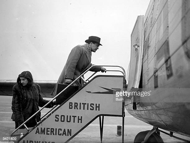 Basil Bardew boarding the air liner 'Star Dust' with air hostess Rita Baines