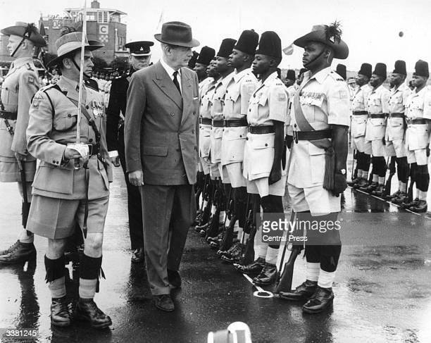 British Prime Minister Harold MacMillan later Earl of Stockton inspecting a guard of honour of the First Kings Rifles in Lusaka Northern Rhodesia