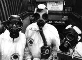 Members of environmental pressure group Friends Of The Earth dressed in gas masks and protective clothing handing out antinuclear material at an...