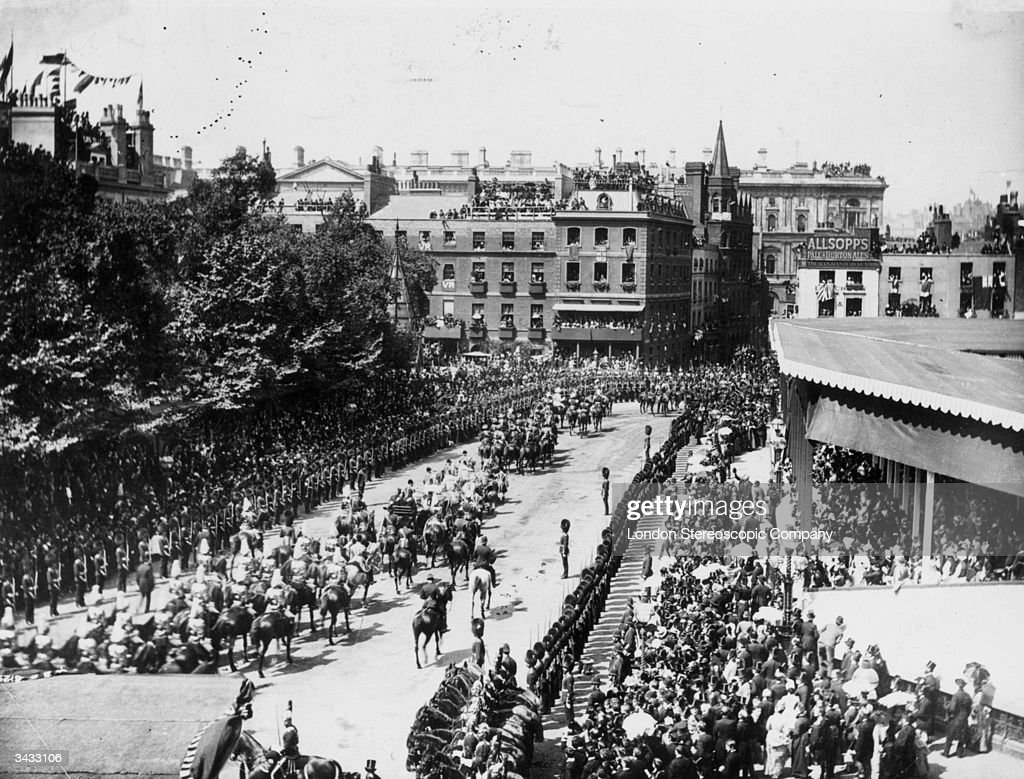 A parade making its way through London towards Westminster Abbey, to celebrate Queen Victoria's Golden Jubilee.