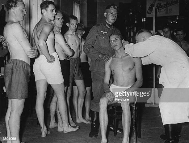 Young conscripted recruits undergoing a medical examination in Berlin Germany