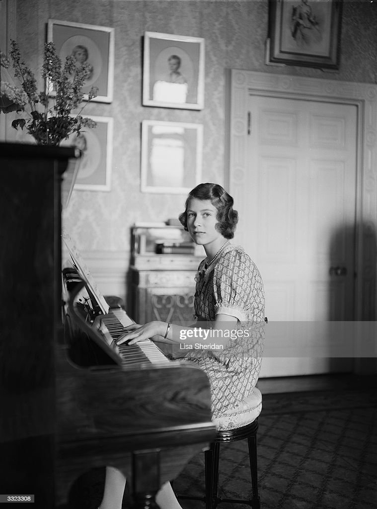 Princess Elizabeth playing a piano at Windsor Castle, Berkshire.