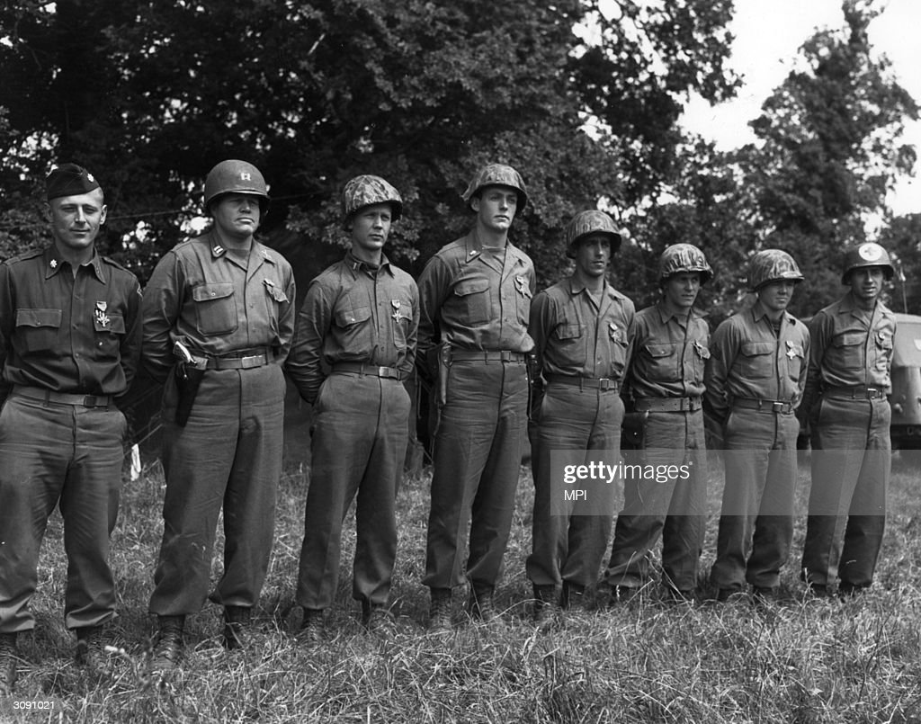 Members of a American Ranger unit who received the Distinguished Service Cross for bravery in France James E Rudder Richard Sullivan Otto Masny Edgar...