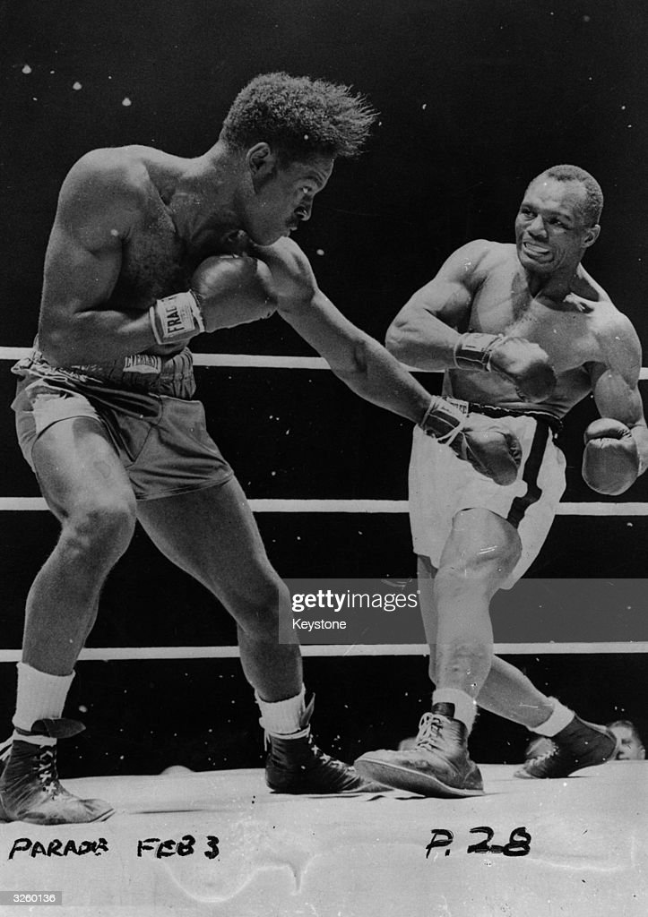 <a gi-track='captionPersonalityLinkClicked' href=/galleries/search?phrase=Ezzard+Charles&family=editorial&specificpeople=215068 ng-click='$event.stopPropagation()'>Ezzard Charles</a> (left) in action against Jersey Joe Walcott during their world heavyweight title fight in Chicago. Charles was awarded the title on points.