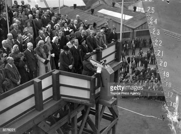 Lady Mitchell wife of the Major General Sir Philip Mitchell the Governor of Kenya launching the Union Castle liner 'Kenya Castle' at the Harland and...