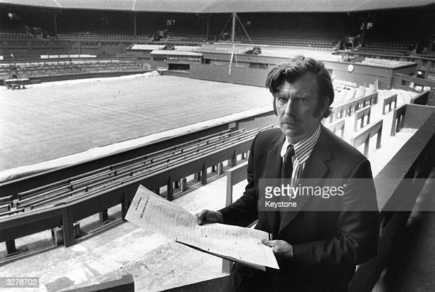 Wimbledon Tennis Tournament referee Mike Gibson in the stands of the Centre Court with the revised list of male competitors after the recent boycott...
