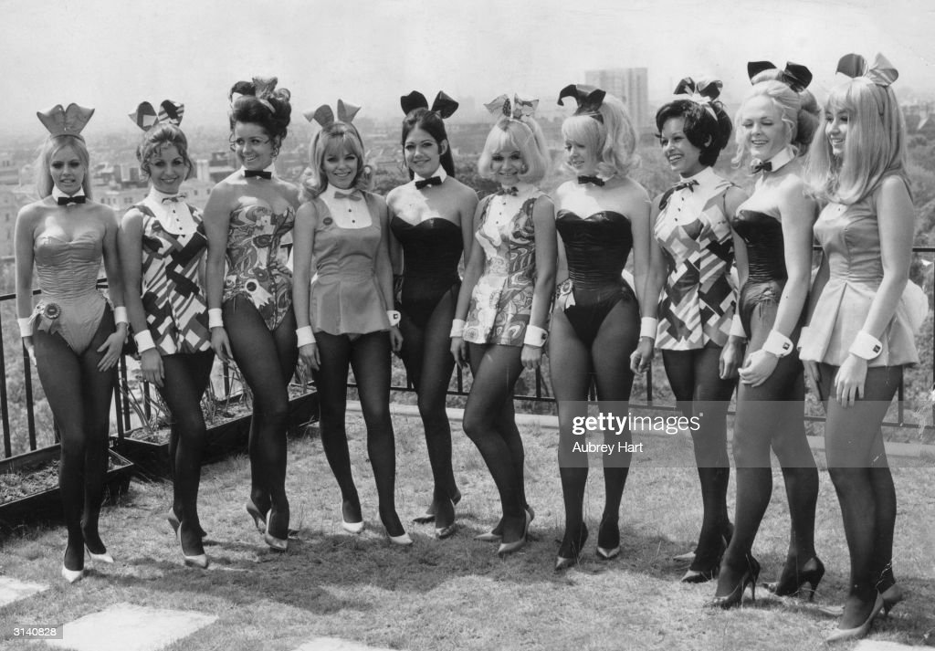 Bunny Girls in costume pose on the roof of the Playboy Club London