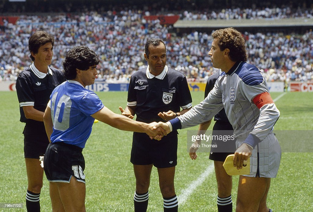 22nd June 1986, 1986 World Cup Finals, Quarter Final in Mexico City, England captain Peter Shilton shakes hands with Argentina captain Diego Maradona before the game in which Maradona scored his infamous 'hand-ball' goal
