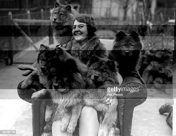 Mrs Bernard Cathbert and her chow dogs at home in Omar House Catford London