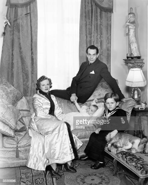 Actors Adrianne Allen and Raymond Massey at home with their two children baby Anna Massey and Daniel Massey