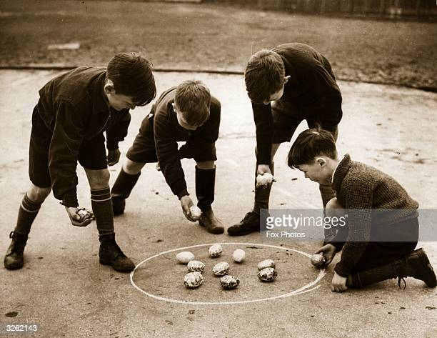 Four enterprising boys evacuated from Stoke Newington London to Hertfordshire use Easter eggs to play a game of marbles