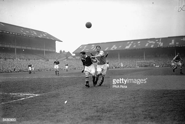 Arsenal's Denis Compton and Winter of Chelsea tussle for possession of the ball during the FA Cup semifinal replay between Chelsea and Arsenal at...