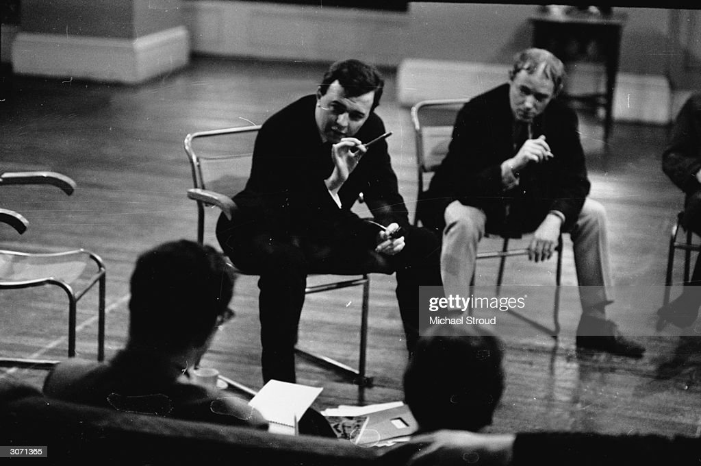 Opera and stage director Peter Hall, facing camera on left, in discussion with members of the Royal Shakespeare Company.