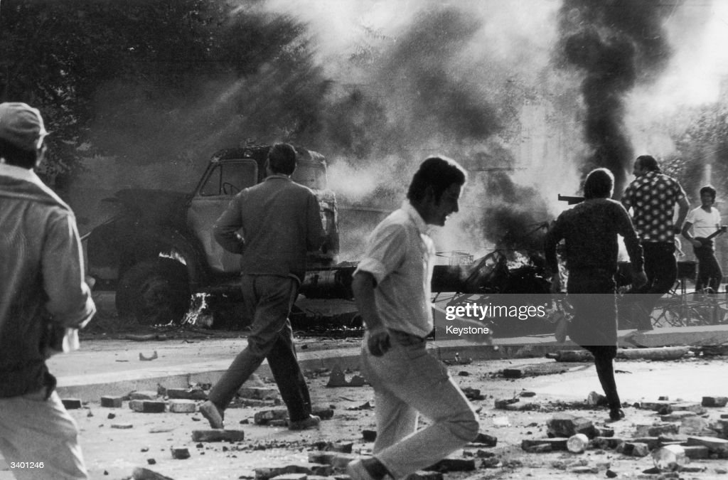 A lorry burns in the Argentine city of Cordoba following rioting by workers