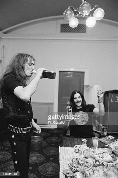 Fast Eddie Clarke and Lemmy Kilmister from Motorhead drinking whiskey and vodka backstage at City Hall in Newcastle on March 22nd 1982