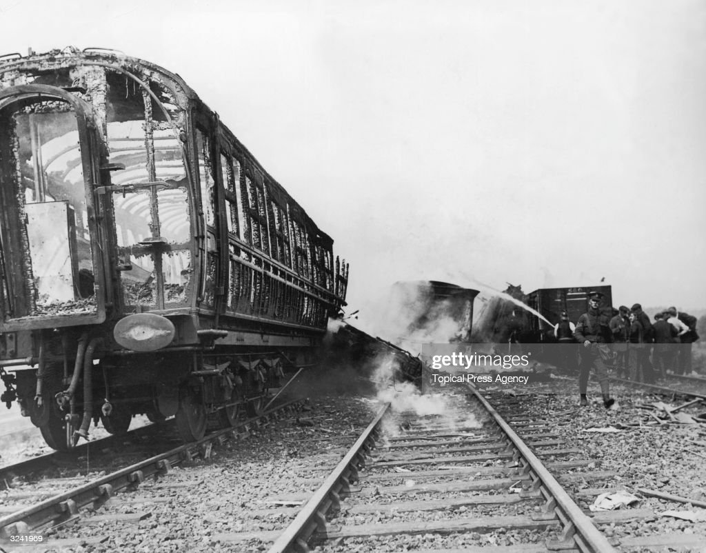 A burntout carriage balanced precariously on the rails after a troop train crashed at Gretna Green in southwest Scotland Many soldiers were injured...