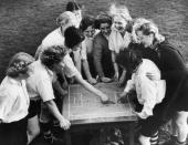 Members of the Preston Ladies Football Club listen to their captain Miss Parr as she discusses tactics with the aid of a cloth pitch diagram They are...