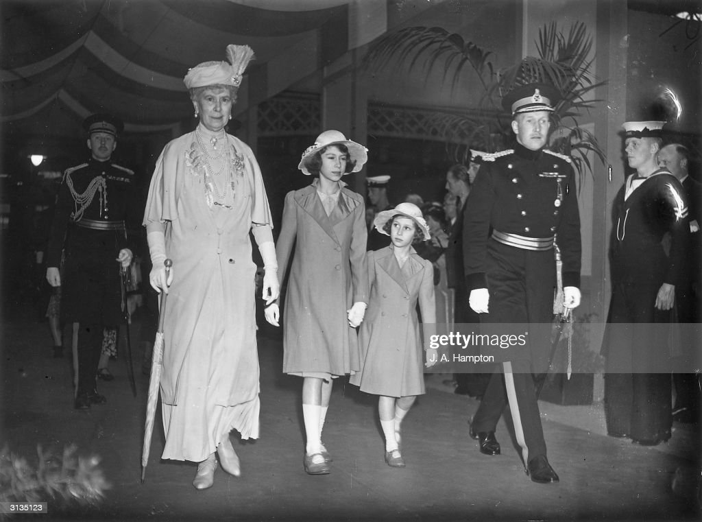 Queen Mary and her two granddaughters, Princess Elizabeth (later Queen Elizabeth II of Great Britain) and Princess Margaret (1930 - 2002), attending an afternoon performance at the Royal Tournament in Olympia.