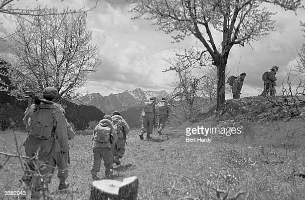 A band of Greek army commandos on the move during the Greek Civil War Commandos number around 2000 out of an army of 140000 Original Publication...