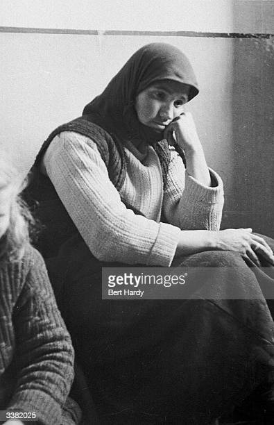 A Greek woman sits in prison charged with aiding the rebel forces during the Greek Civil War Original Publication Picture Post 4551 The War For...