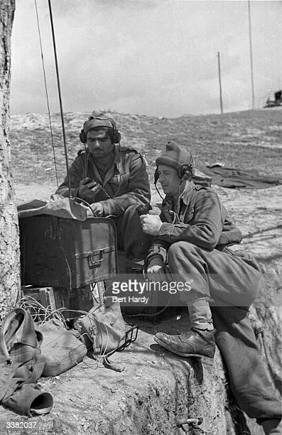 A pair of Greek soldiers make contact with their troops on a field radio during the Greek Civil War Original Publication Picture Post 4551 The War...