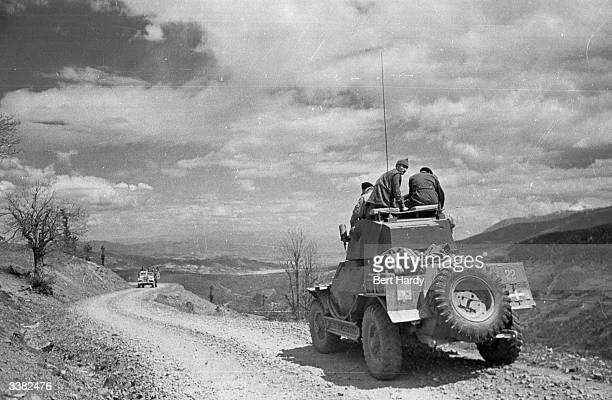A truck carries a band of government soldiers along a rocky mountain pass during the Greek Civil War Original Publication Picture Post 4551 The War...