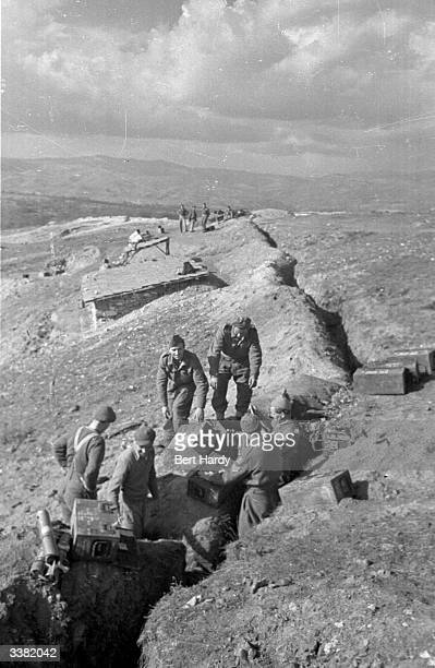 Government troops prepare to launch an offensive against the rebels from a trench dug in the mountains of northern Greece during the Greek Civil War...