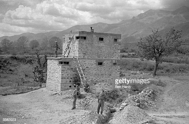 Greek soldiers guard a small watchtower built to guard the railway near the Bulgarian border with northern Greece during the Greek Civil War Original...