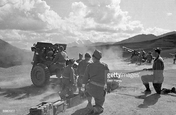 The Greek army opening fire on guerrilla troops during the Greek Civil War Original Publication Picture Post 4551 The War For Greece pub 1948