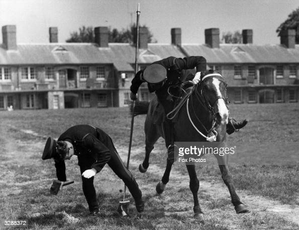 At Beaumont Barracks Aldershot two military policemen rehearse for the tent pegging display in preparation for the White City Tattoo in London