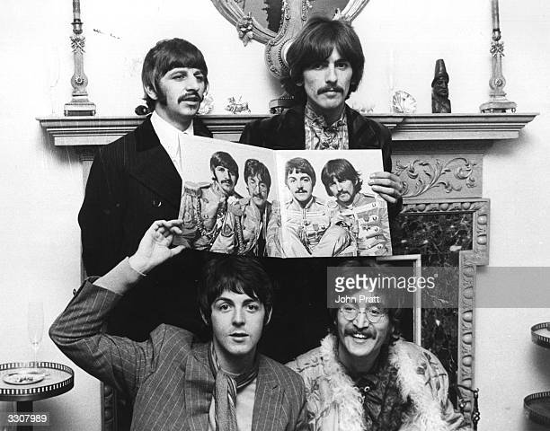 The Beatles clockwise from top left Ringo Starr George Harrison John Lennon and Paul McCartney pose for a photocall to promote their new album...