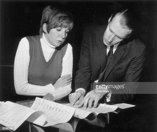 George Martin the producer of the Beatles with Cilla Black whose single 'Work Is A Four Letter Word' he is to produce