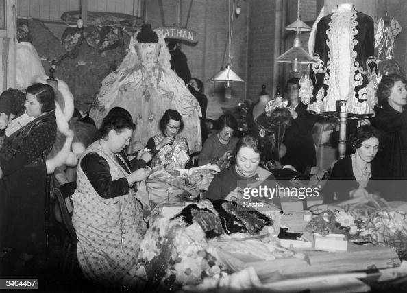 Seamstresses at work on costumes for pantomimes at Nathan's theatrical outfitters in London