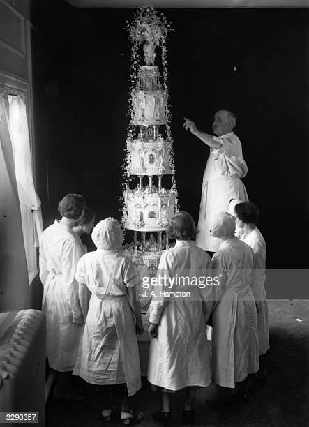 The Royal wedding cake made by Messrs McVitie Price for the marriage of the Duke of Kent and Princess Marina of Greece It stands at nine feet high...