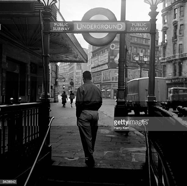 A man travels by tube to Soho in the City of Westminster