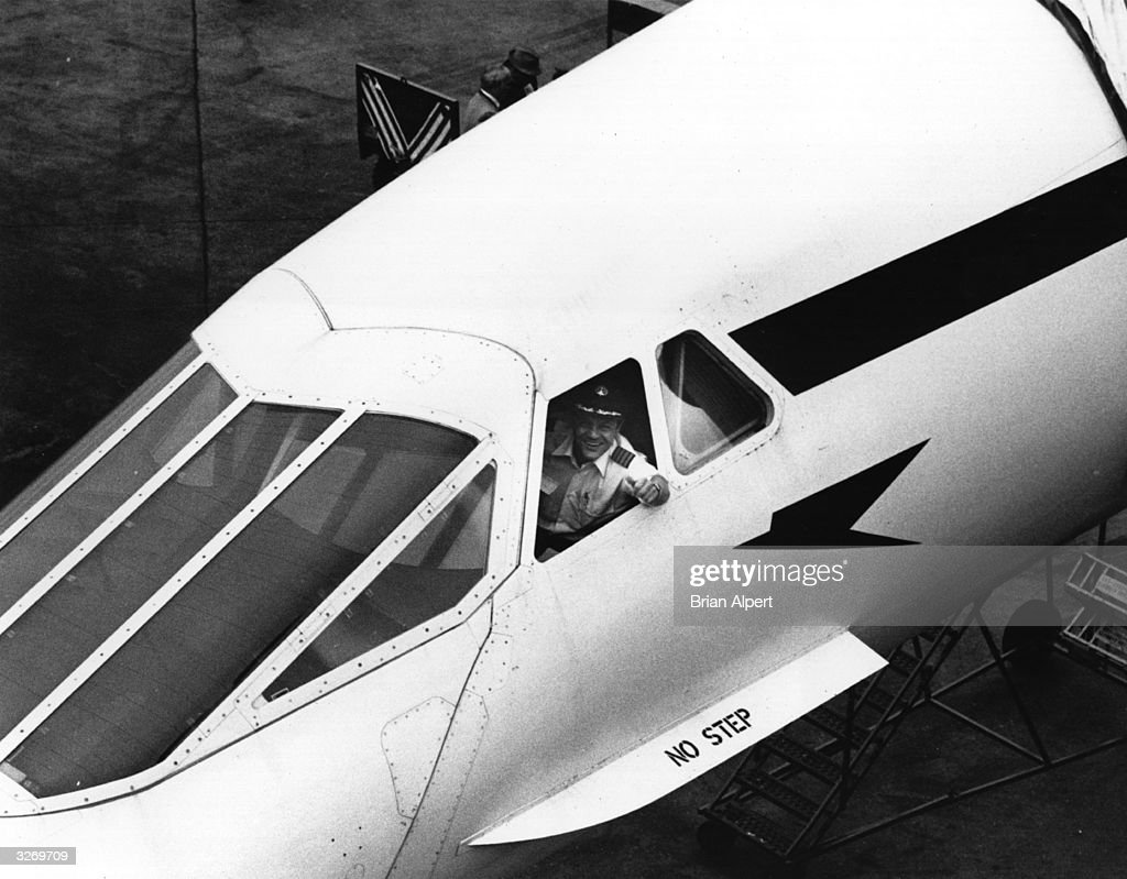 Captain Brian Walpole smiles from the cockpit of Concorde, having flown from London to New York on the its first commercial flight.
